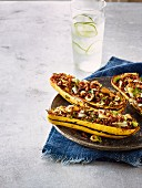 Delicata squash stuffed with quinoa, leek and hazelnuts