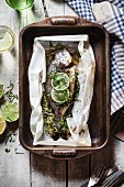 Marinated seabream with limes in parchment paper