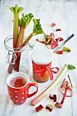 Homemade rhubarb compote in a cup and in a jar