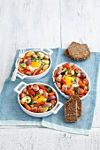 Sausage and vegetable bake with egg served with wholemeal bread