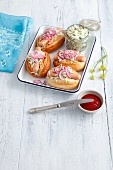 Hot dogs with coleslaw and pickled red onions