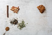 Ingredients for super food drinks: licorice, cardamom pods, cinnamon, barley, green tea, peppermint and chaga