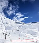 Ski lift and slopes