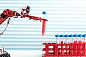 Robotic arm holding test tube