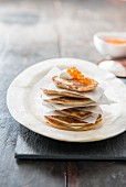 Blintzes with trout caviar