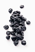 Dried blueberries on a white surface
