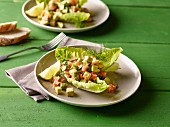 Avocado and salmon salad with dill on cos lettuce leaves