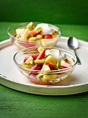 Fruit salad with limes and a dollop of cream