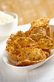 Parmesan crisps with sesame seeds and rosemary