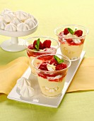 Raspberry desserts with cream and meringue