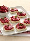 Crostini topped with a beetroot spread