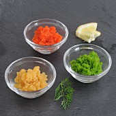 Flying fish tobiko roe in glass bowls
