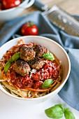Spaghetti with meatballs, tomato sauce and basil