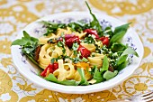 Tagliatelle with peppers, rocket and garlic oil