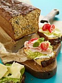 Slices of pumpkin seed and quark bread with a savoury topping