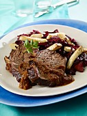 Sauerbraten (marinated pot roast) with red cabbage and roasted celery