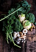 Various types of kale with garlic, turmeric and ginger (ingredients for kale soup)