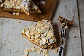 Spanish almond cake on a light wooden surface