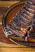 Grilled spare ribs on a rustic plate