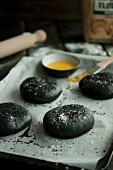 Black hamburger buns coloured with squid ink