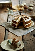Carrot and banana cake with nuts, sliced