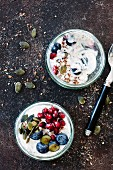 Yoghurt with flax seeds, blueberries, pomegranate seeds and pumpkin seeds