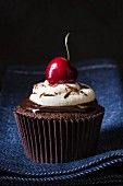 Black Forest cherry cupcake with ganache, cream and cherries