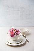White place setting decorated with flowers and name