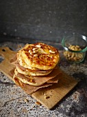 Pancakes with quince spirals and pine nuts