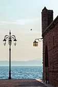 Old toll house in the old town of Lazise, Lake Garda, Italy