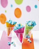 Blue popcorn in colourful paper bags
