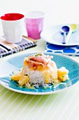 Rice with pineapple, cheese sauce and ham
