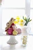 Easter arrangement of bunnies, chicks, narcissus and Easter eggs