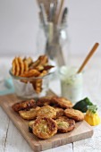 Breaded courgette fritters with a dip