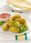 Pea croquettes with a tomato dip