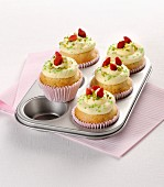 Lemon cupcakes with pistachios and wild strawberries