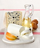 A cheese platter with Roquefort and a roll of goat's cheese