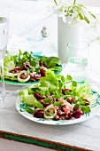 Mixed salad with fresh sweet cherries