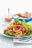 A colourful salad with prawns and mango