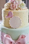 A festively decorated cake in delicate pastel tones