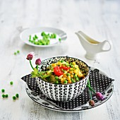 Potato salad with sweetcorn and peas