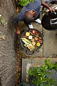 An African-American man at a barbecue (seen from above)