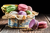 Colourful macaroons in an old metal tin
