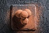 Chocolate pralines on a black stone