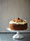 Spice cake with parsnips, oranges, hazelnuts and ginger cream cheese frosting