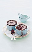 Baked chocolate and cinnamon puddings in ramekins