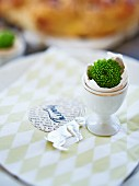 An Easter table decoration with a name tag
