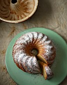 Eggnog Bundt cake dusted with icing sugar, sliced