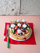 A waffle cake with berries and meringue