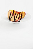 Peach slices drizzled with chocolate sauce
